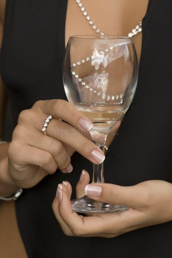 Glace avec du vin blanc images stock