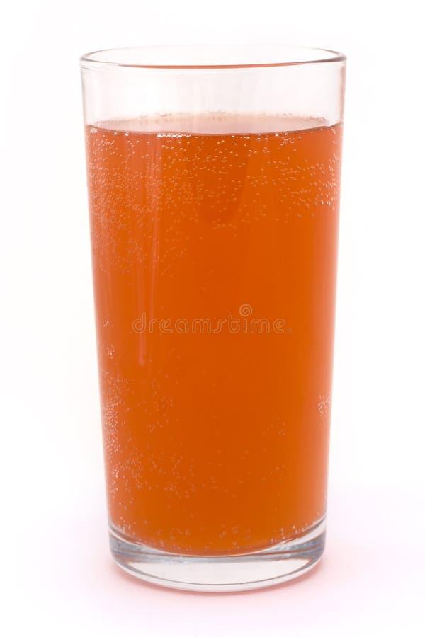 Glace d'orange pétillante au-dessus de blanc photographie stock