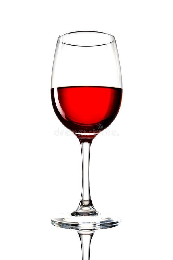 Glace de vin rouge sur un fond blanc et avec l'ombre molle photographie stock libre de droits
