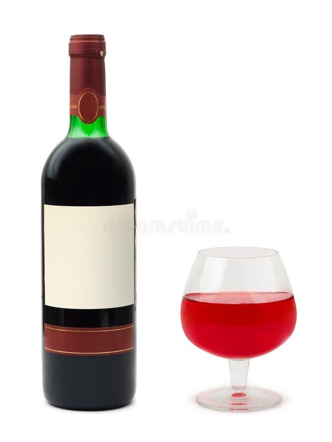 Glace et bouteille de vin avec l'étiquette vide photographie stock