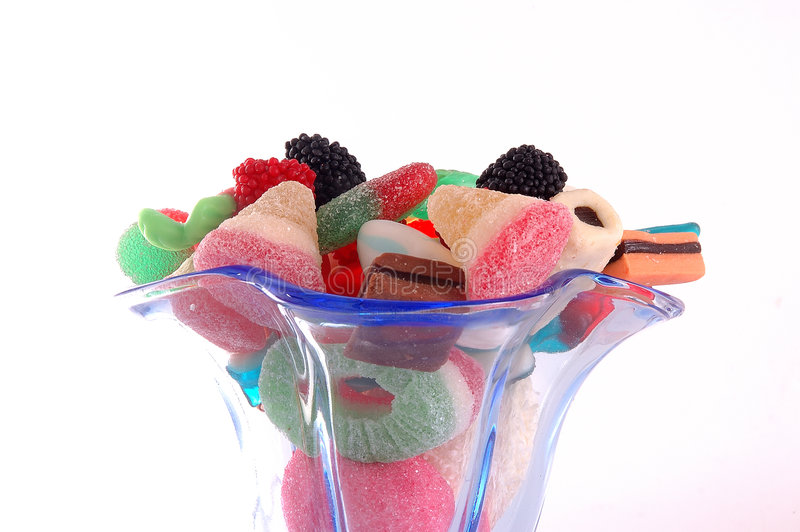 Glace mettante en forme de tasse bleue de sucreries photos stock