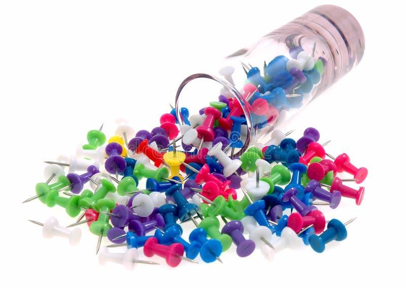Glace renversant des thumbtacks photo stock