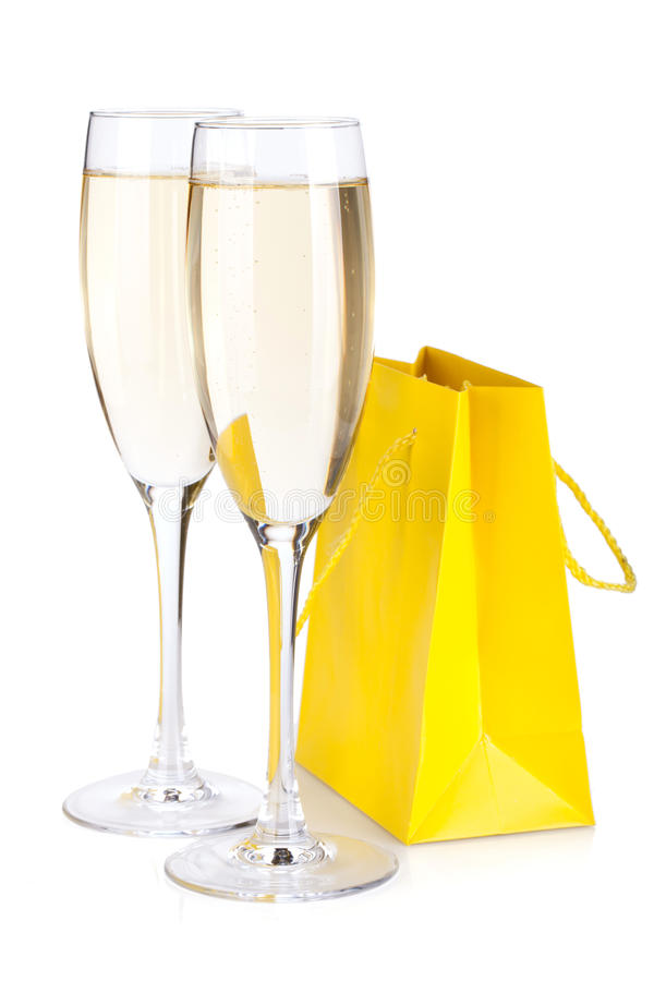 Glaces de Champagne et sac de cadeau images libres de droits