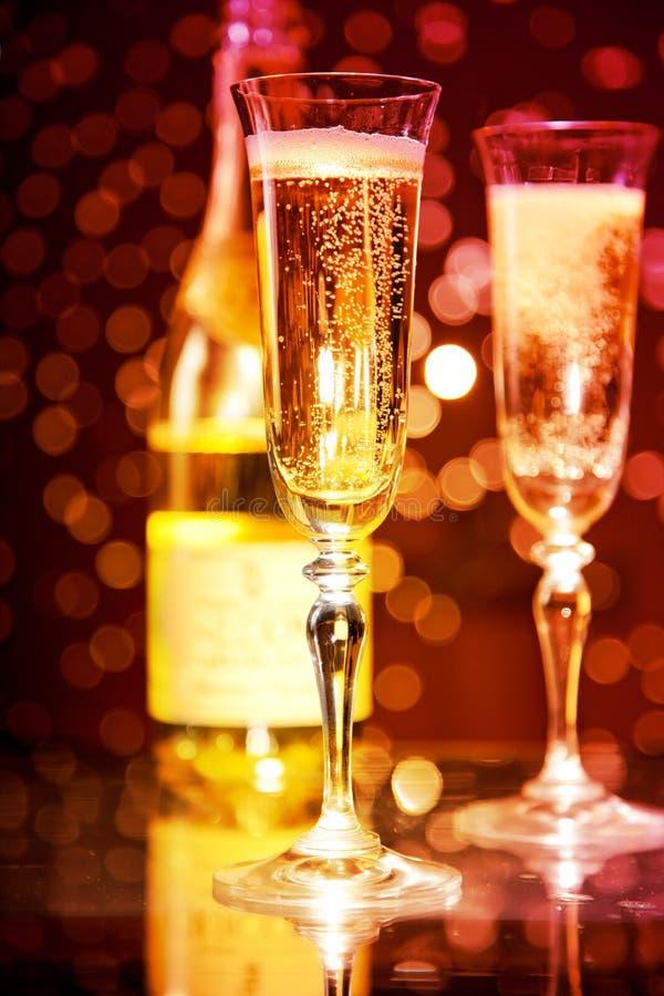Glaces et bouteille de Champagne images stock
