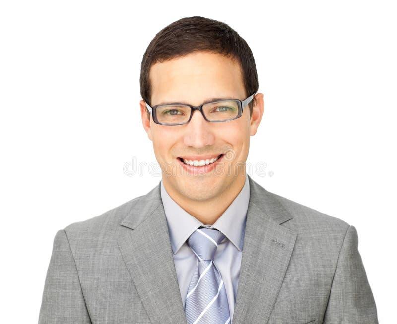 Glaces s'usantes de jeune homme d'affaires charismatique image stock