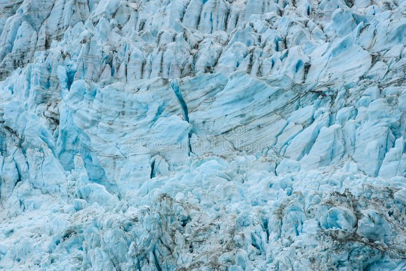 Glacial blues and dirt browns in fractured ice patterns on glacier in Drygalski Fjord, South Georgia, as a nature background royalty free stock photos