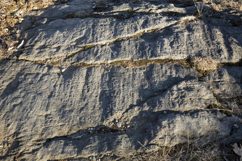 Glacial grooves in granite bedrock, legacy of the ice age. Glacial grooves in granite schist bedrock, legacy of the last ice age, in Case Mountain Park stock images