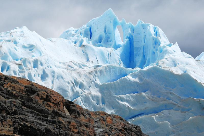 Glacial ice Perito Moreno Glacier - National Park Los Glaciares - Argentina. Light blue glacial ice field Perito Moreno Glacier with dark clouds seen from stock photos