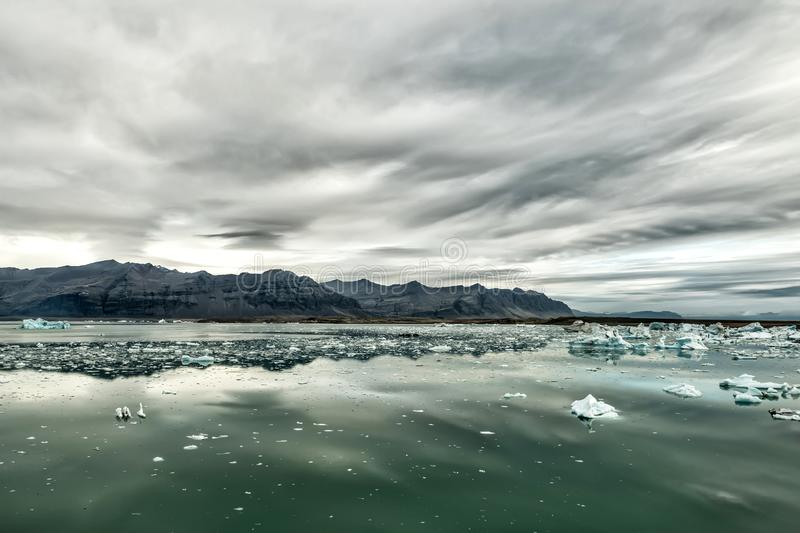 Glacial lake. Gloomy dramatic landscape of Iceland. royalty free stock photos