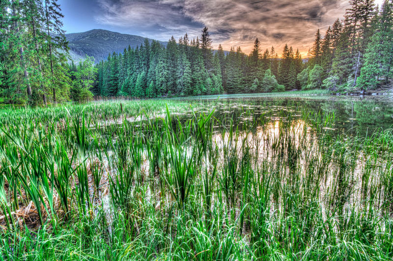 Glacial lake in Low Tatras mountains, Slovakia. Glacial lake in Low Tatras mountains at sunset, Slovakia. HDR image royalty free stock photo
