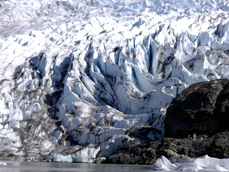 Glacial Ridges. The leading edge of Mendenhall Glacier (Juneau AK), also called Auke (Auk) Glacier by naturalist John Muir, which has receded by 1.75 miles since stock photos