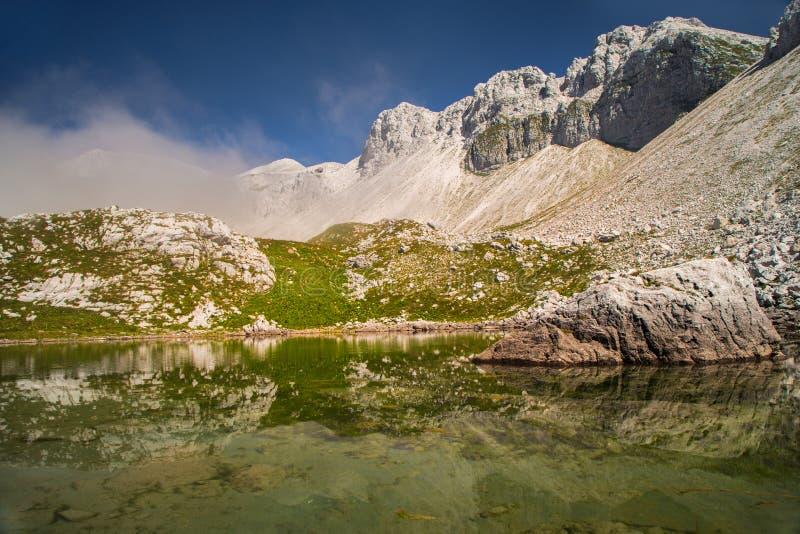 Glacial small lake Lužnica. At Julian Alps, Krn, Slovenia royalty free stock photo
