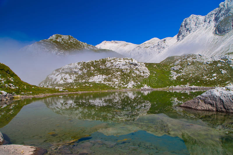 Glacial small lake Lužnica. At Julian Alps, Krn, Slovenia stock images