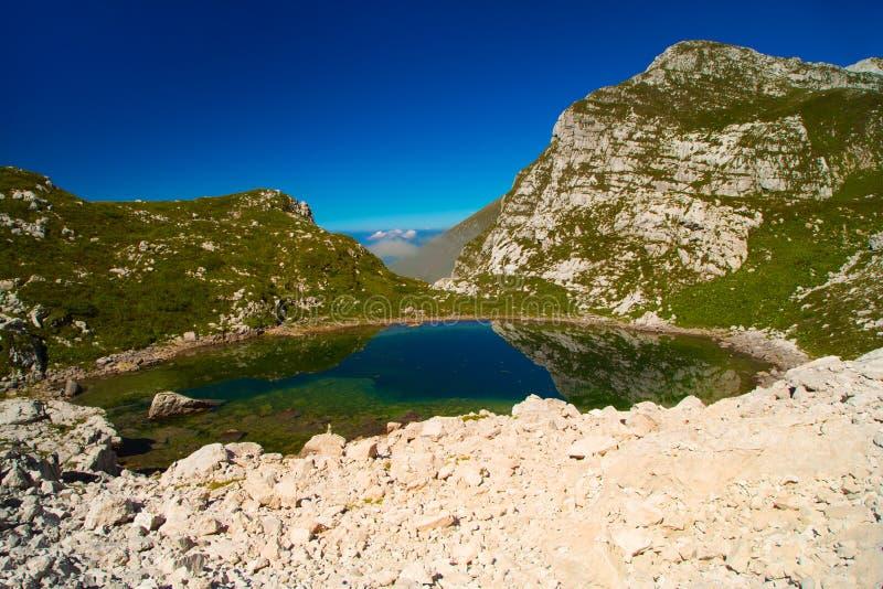 Glacial small lake Lužnica. At Julian Alps, Krn, Slovenia stock photos