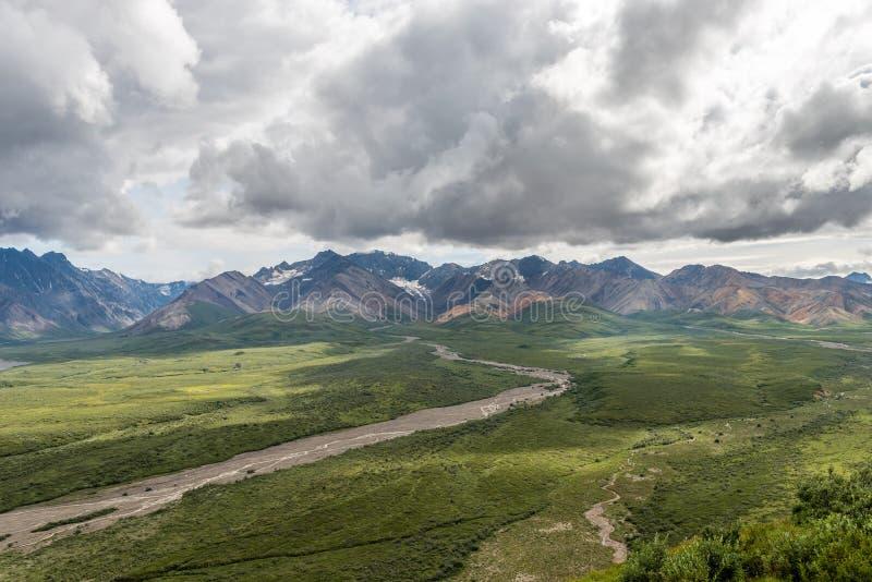 A Glacial Stream Runs Down from the Alaska Range royalty free stock photography