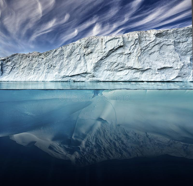 Glacier with above and underwater view taken in greenland. royalty free stock photography