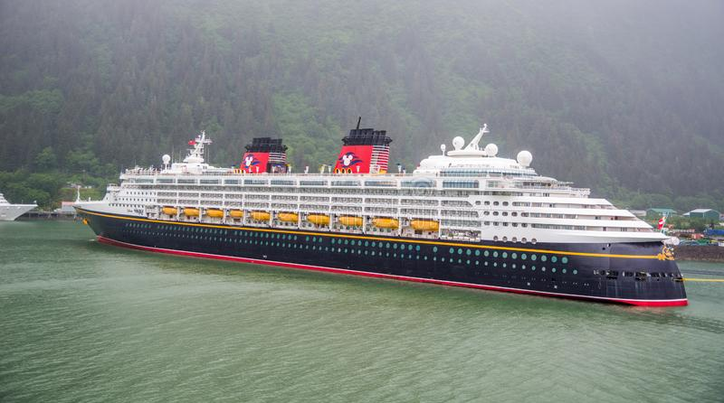 Ocean cruising with the Disney ship on its way to Glacier Bay, Alaska. Glacier Bay, Alaska / USA - 06/29/2015 Ocean cruising with the Disney ship on its way to stock photos