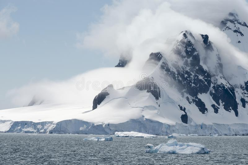 Glacier And Clouds Covering The Coastline Of Paradise Bay, Antarctic Peninsula.  royalty free stock image
