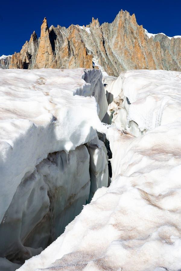 Glacier crevasse, Aiguilles du Diable peak, Mont Blanc massif. Big glacier crevasse ice crack, Aiguilles du Diable, Grand Capucin peaks ridge beautiful landscape stock photos