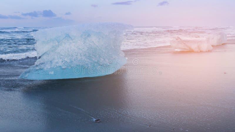 Glacier Ice breaking on black sand beach royalty free stock photos