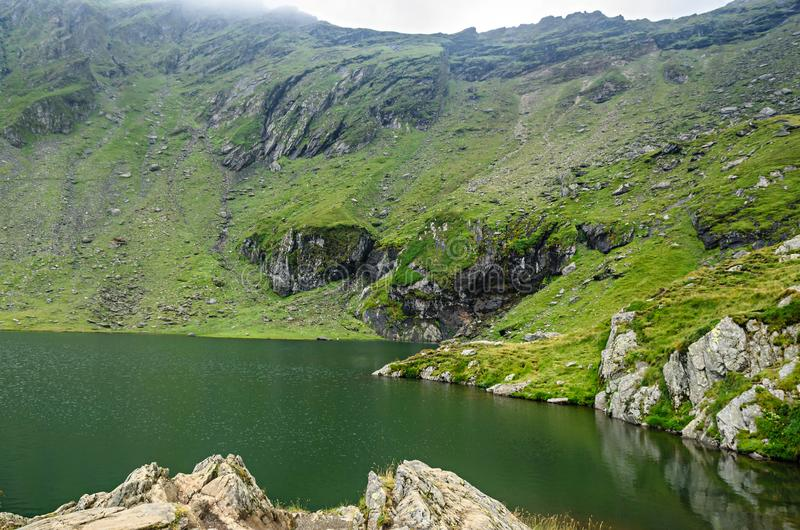 The glacier lake called Balea Balea Lac on the Transfagarasan. Road from Fagaras mountains royalty free stock photos