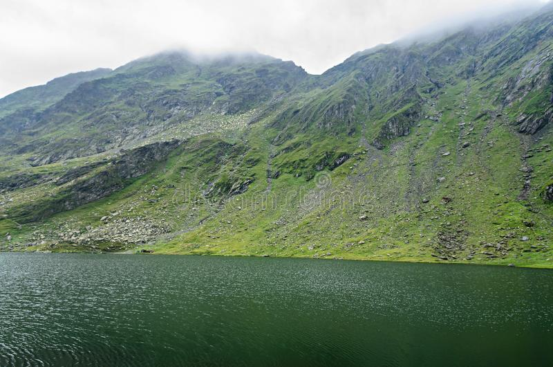 The glacier lake called Balea Balea Lac on the Transfagarasan royalty free stock photo