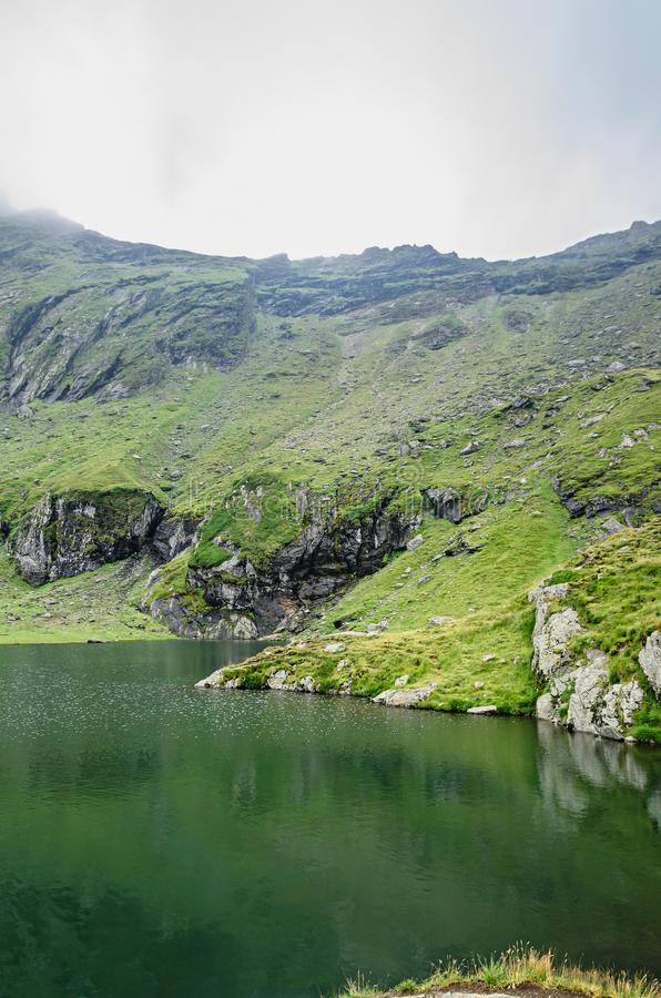 The glacier lake called Balea Balea Lac on the Transfagarasan royalty free stock image