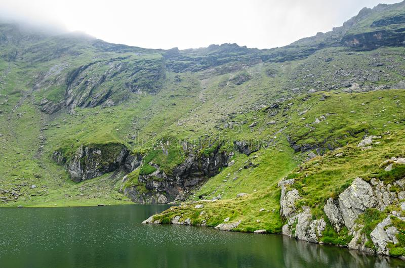 The glacier lake called Balea Balea Lac on the Transfagarasan stock photography