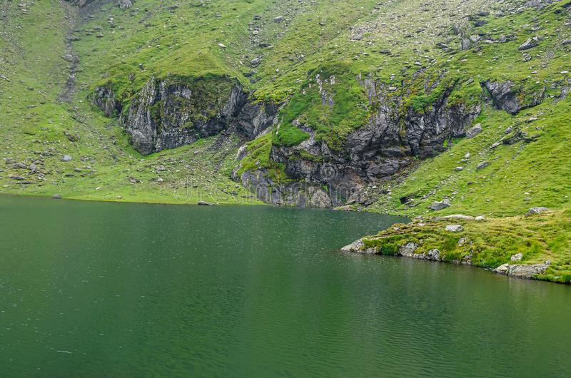 The glacier lake called Balea Balea Lac on the Transfagarasan stock images