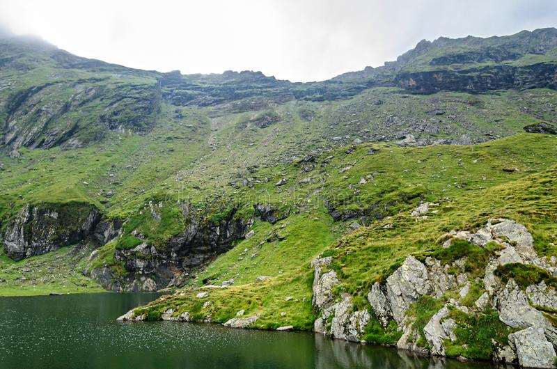 The glacier lake called Balea Balea Lac on the Transfagarasan royalty free stock photography