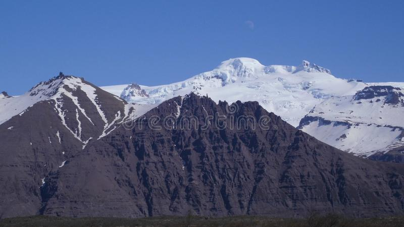 Summit. Rocky Lava Mountains Cover With Snow And Ice stock photography
