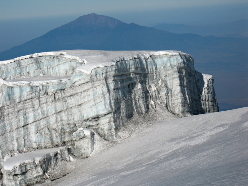 Glacier of Mt. Kilimanjaro. View from glacier of Mt. Kilimanjaro, the roof of Africa, the highest mountain of Africa. In the background Mt. Montemero near towm stock photo