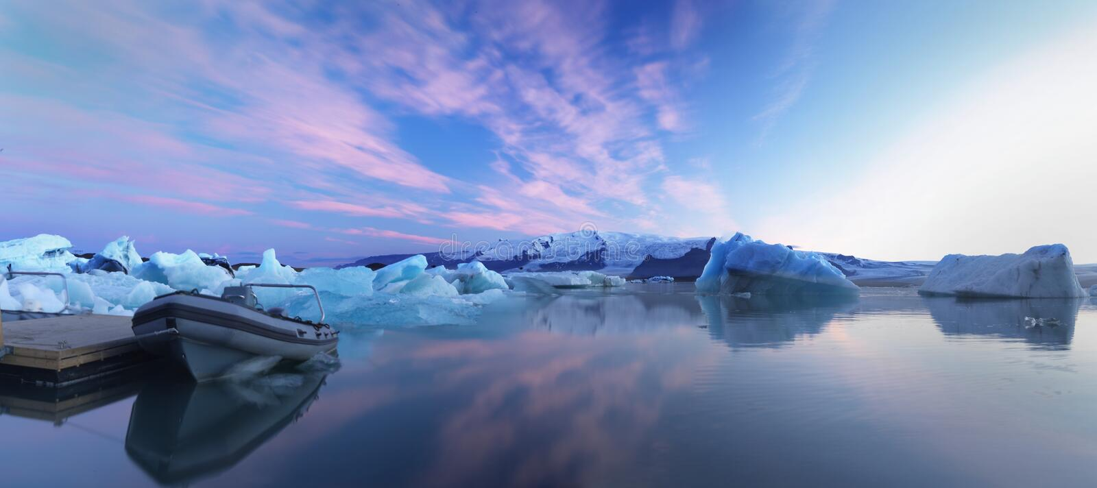 Download Glacier Pond With Rubber Boats Royalty Free Stock Photo - Image: 25785645