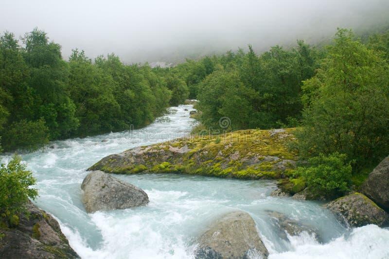 Glacier river in fog stock photo