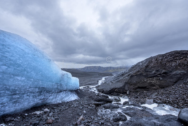 Glacier in rugged terrain stock photography