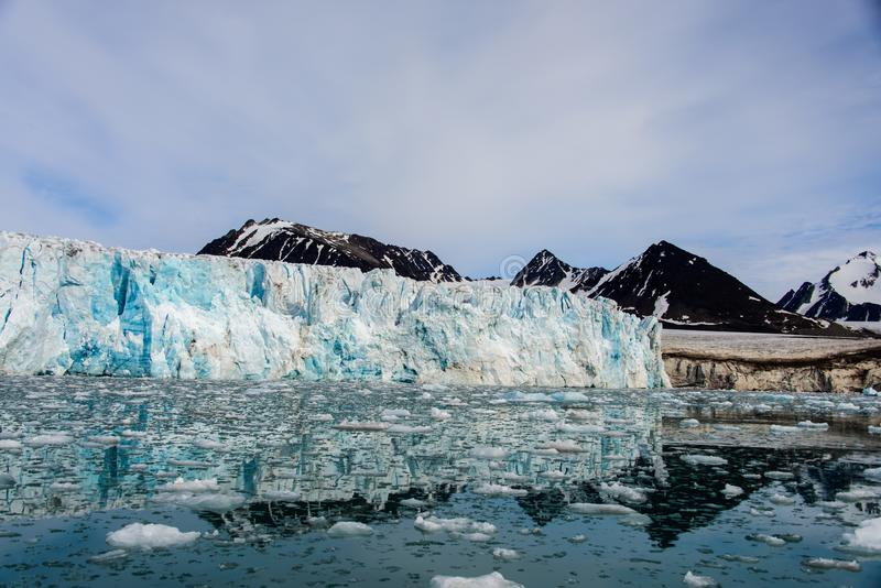 Arctic landscape with glacier in Svalbard. Norway at summer time. With beautiful reflrction royalty free stock image