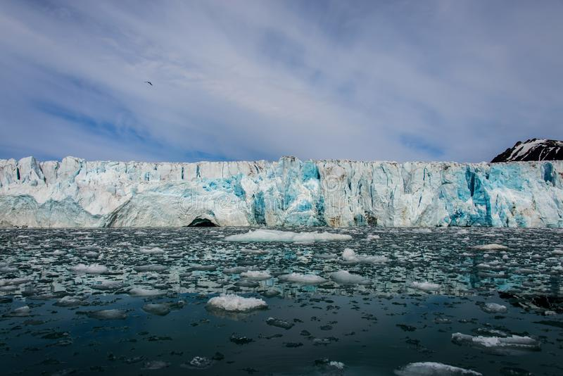 Arctic landscape with glacier in Svalbard. Norway at summer time. With beautiful reflrction stock images
