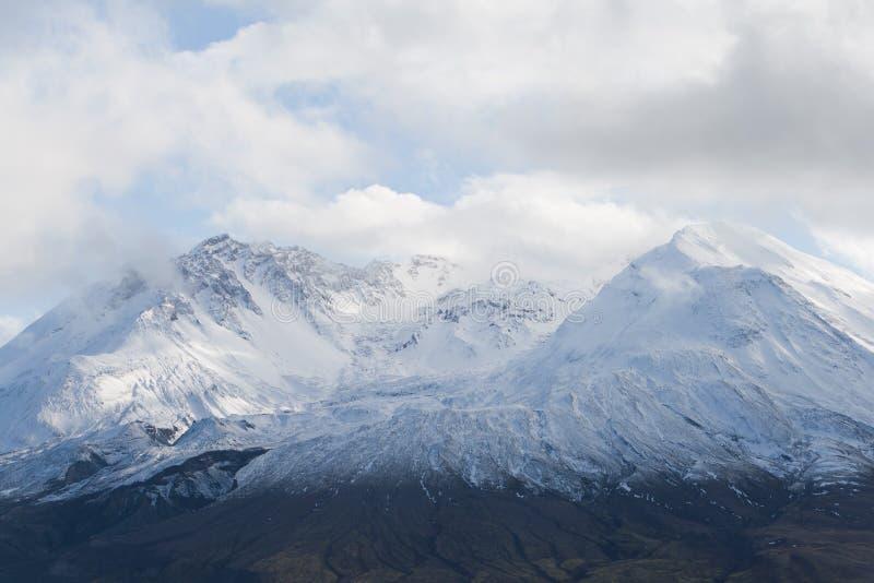 Glacier top of mount Saint Helens. Volcano mount Saint Helens decapitated top with glacier in clouds royalty free stock photos