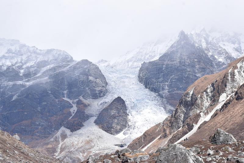 Glacier between two mountains of Nepal`s Langtang National Park. Nepal royalty free stock photography