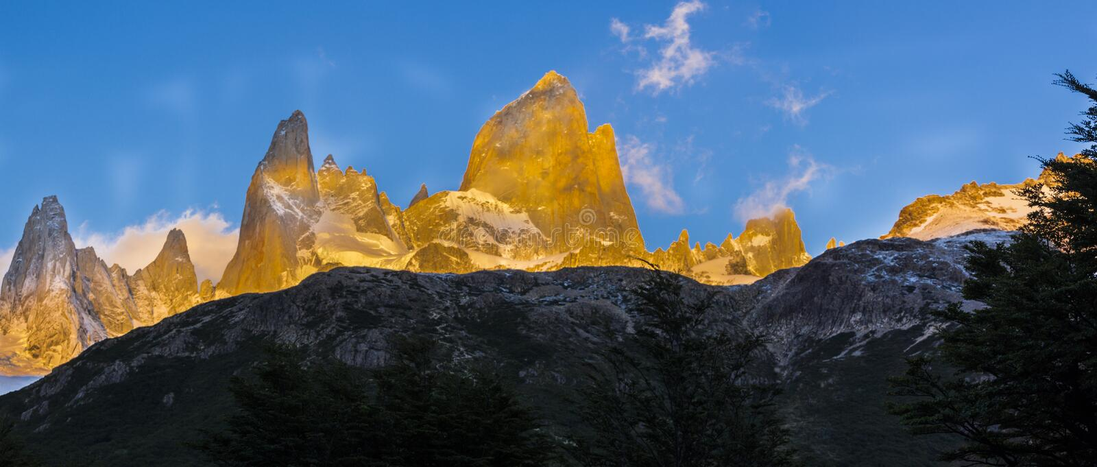 Fitz Roy amazing views inside the Argentina Patagonia with an awesome sunrise filling the rock towers with an increcible orange co stock photos