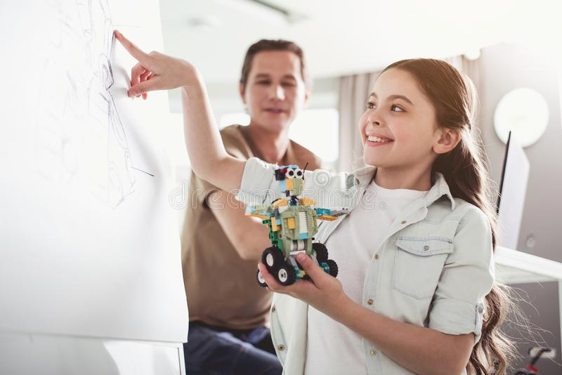 Glad child showing on drawn detail stock photography