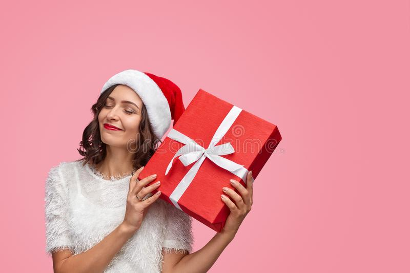 Glad female receiving New Year gift royalty free stock photos