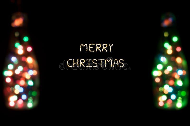 Glad jul med bokehljus arkivfoto