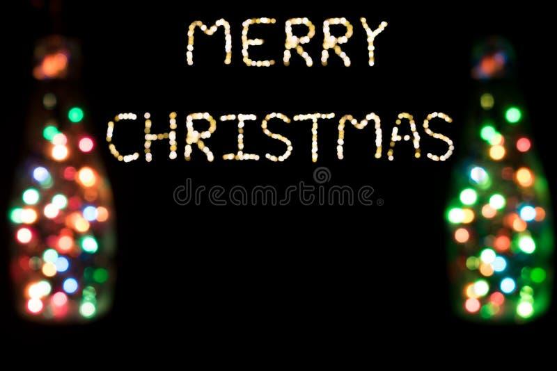 Glad jul med bokehljus arkivfoton