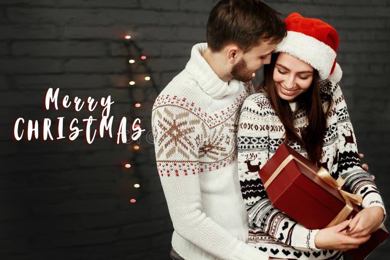 Glad jul smsar teckenhälsning med stilfull lycklig parintelligens royaltyfria foton