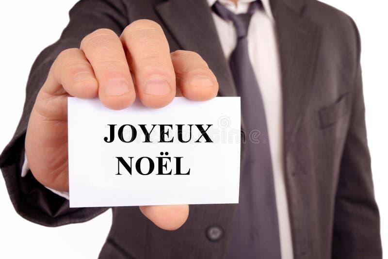 Glad jul som är skriftlig i franskt på ett kort vektor illustrationer
