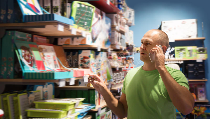 Glad man in front of difficult choice in store stock photos