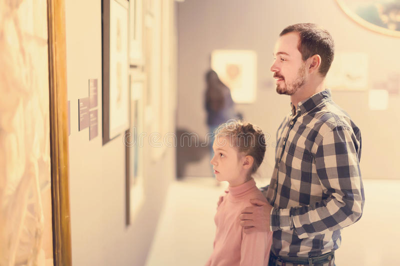 Download Glad Man And Girl Exploring Exhibition Of Photos Stock Photo - Image: 86112544