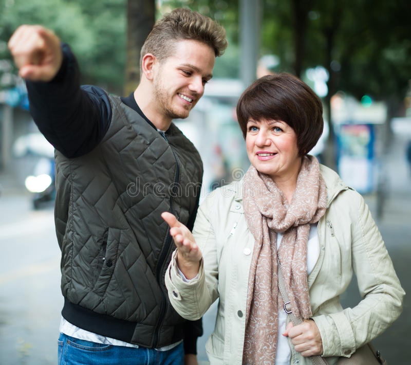 Download Glad Man Points The Direction To Woman Stock Photo - Image: 83701368