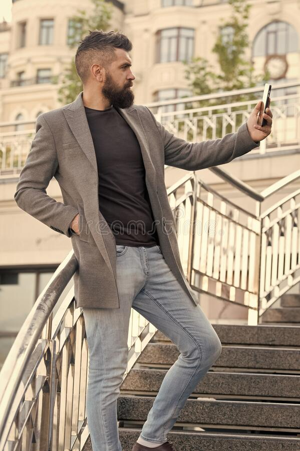 Glad to see you. Man taking selfie photo smartphone urban background. Streaming online video call. Mobile internet royalty free stock photos